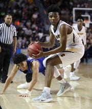 Sanford's Jyare Davis (right) grabs a free ball away from Dover's Eden Davis in the first half of the DIAA state championship Saturday at the Bob Carpenter Center.