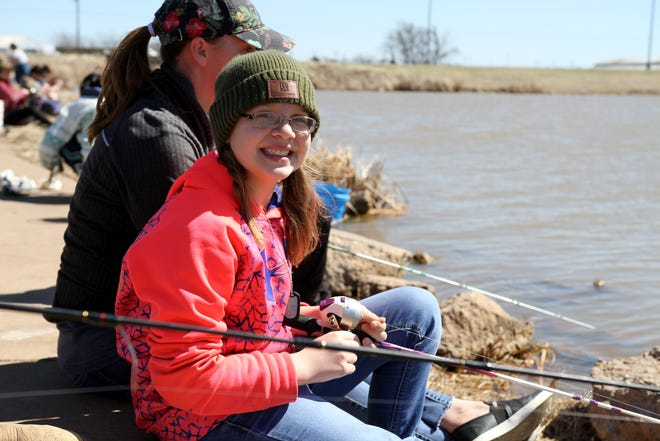 In this 2019 photo, Syndey and Jessica Bartels fish during Kid Fish Rodeo at Plum Lake on Sheppard Access. This year's fishing event will be 10 a.m. to noon Saturday, March 7.