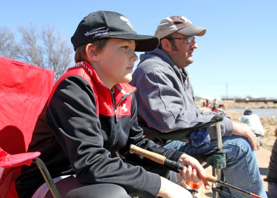 Bryson,left, and Bryan Collier fish during Kid Fish Rodeo Saturday, March 9, 2019, at Plum Lake on Sheppard Access.