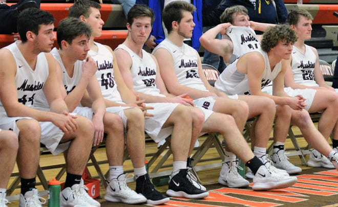 John Glenn players sit on the bench after losing a hard-fought 54-51 game to Steubenville in Saturday's district final.