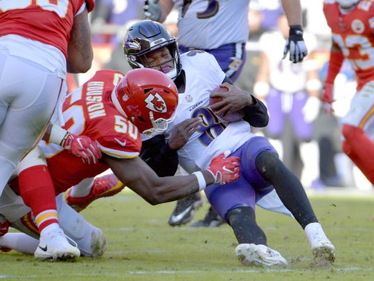 Kansas City outside linebacker Justin Houston (50), here sacking Ravens QB Lamar Jackson. was released by the Chiefs on Sunday.