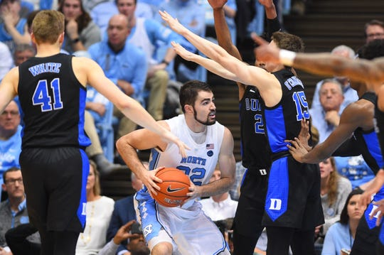 North Carolina Tar Heels forward Luke Maye (32) with the ball as Duke Blue Devils forward Jack White (41) and guard Alex O'Connell (15) defend in the first half at Dean E. Smith Center.