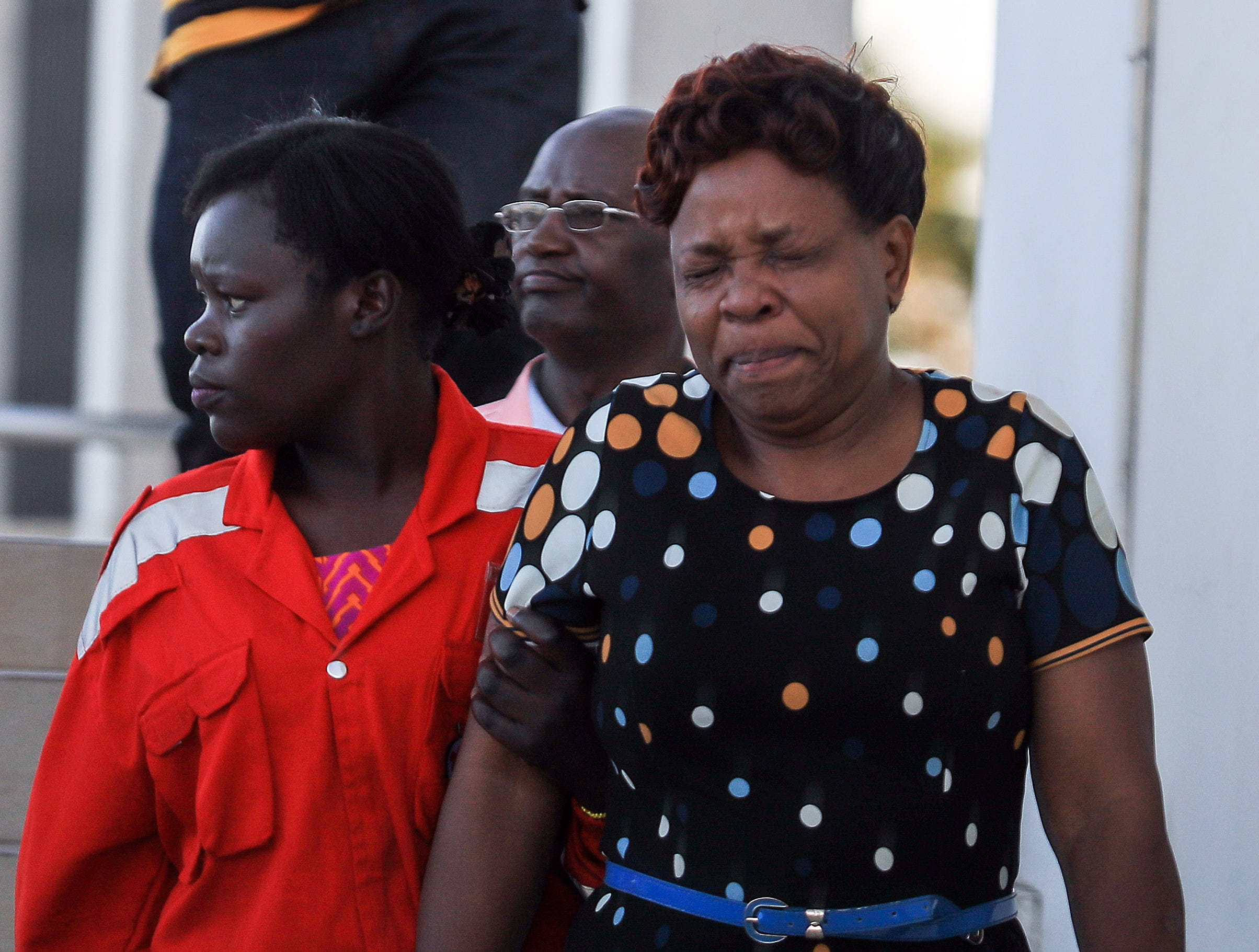 A Kenyan woman, right, is comforted by a Red Cross worker at Jomo Kenyatta International Airport (JKIA) in Nairobi, Kenya after getting information about her loved ones that were on board the Ethiopian Airlines plane that crashed.