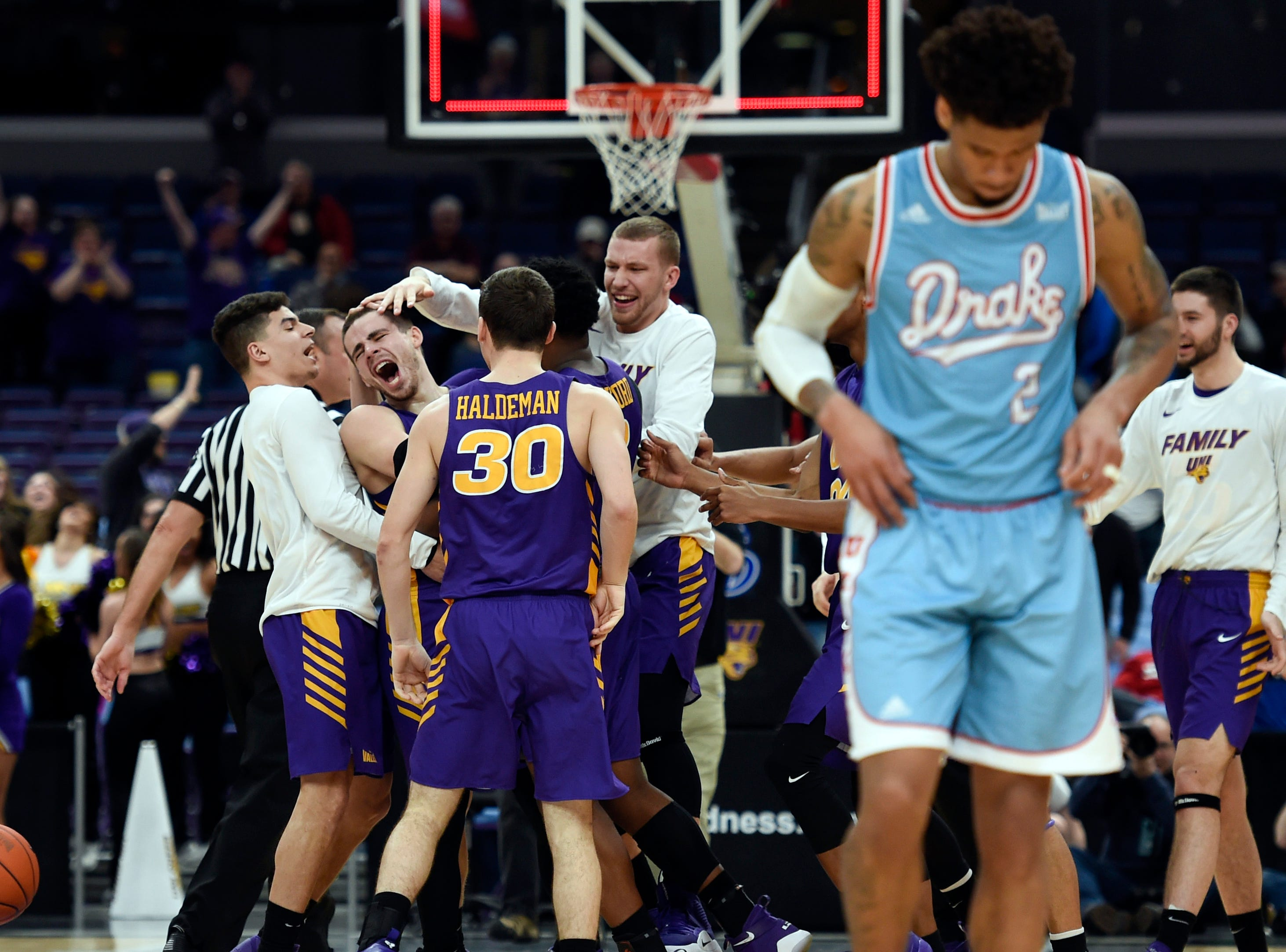 March 9: Northern Iowa Panthers guard Wyatt Lohaus is congratulated by teammates after making a basket to beat the Drake Bulldogs in the Missouri Valley Conference tournament.