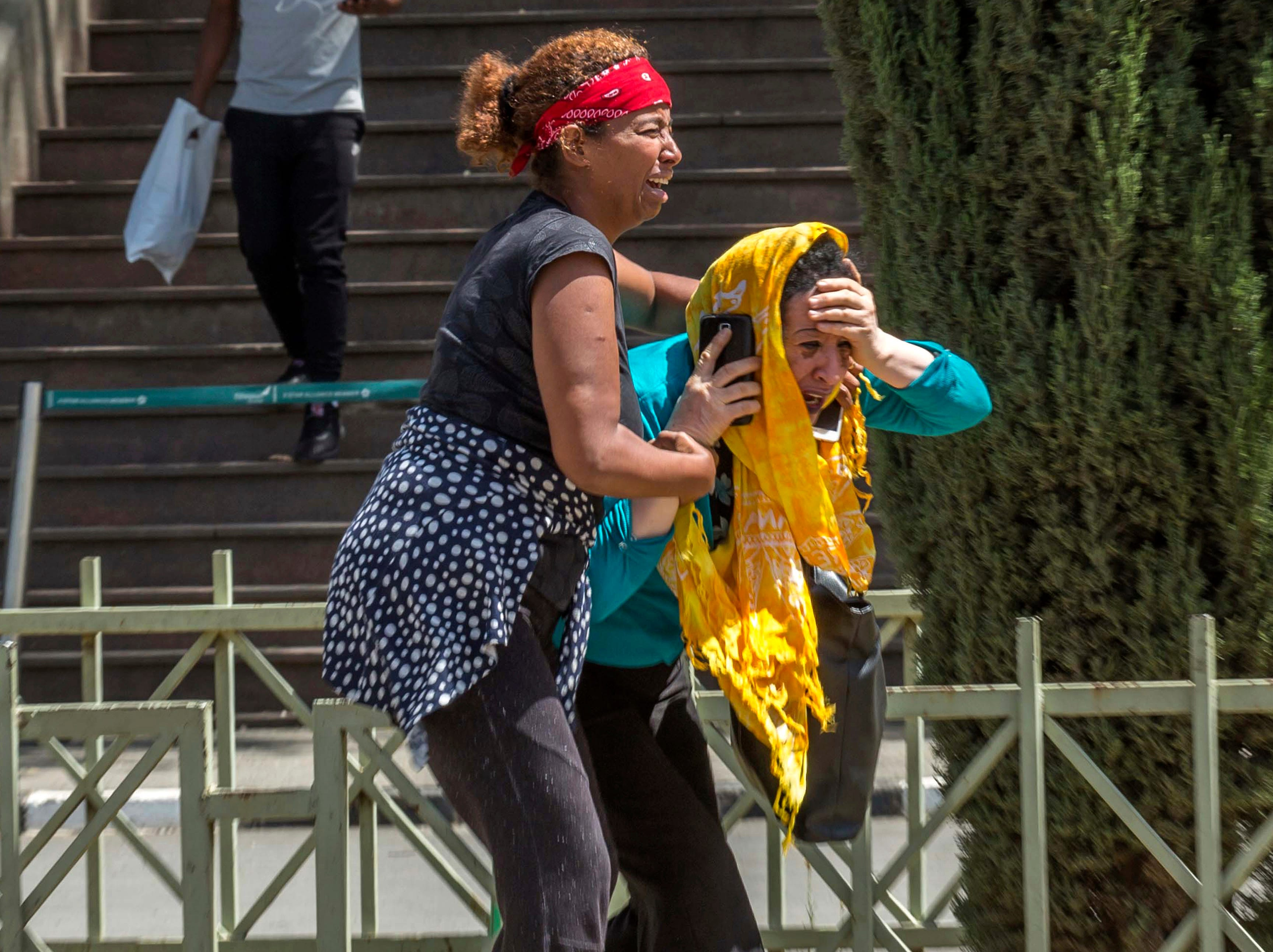 Family members of the victims involved in a plane crash react at Addis Ababa International Airport in Ethiopia.