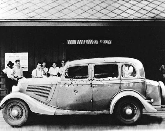 Bonnie and Clyde's bullet-riddled car went on display after the infamous couple's death.
