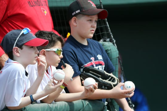Red Sox fans wait for autographs at spring training.