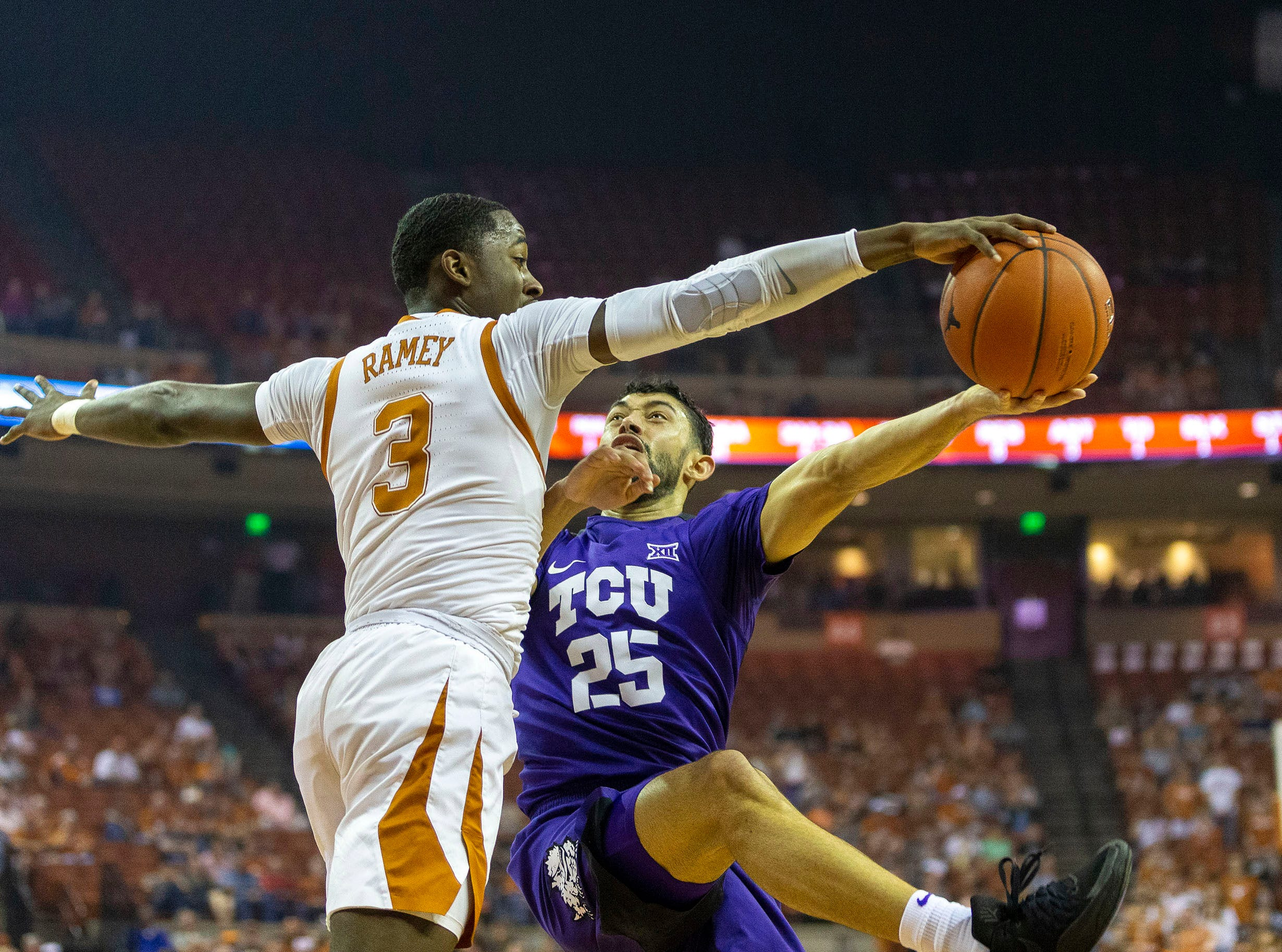March 9: Texas Longhorns guard Courtney Ramey blocks TCU Horned Frogs guard Alex Robinson (25) in the first half at Frank Erwin Center.