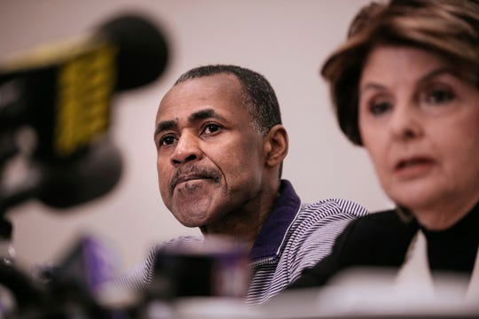 Gloria Allred, seated with Gary Dennis of Pennsylvania, takes questions during a news conference announcing a videotape said to present further evidence of wrongdoing by recording artist R. Kelly Sunday on March 10, 2019, in New York.