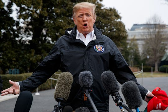 President Donald Trump talks with reporters outside the White House before traveling to Alabama to visit areas affected by the deadly tornadoes, March 8, 2019, in Washington.