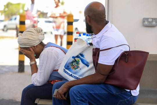 A Djiboutian national Hiba, left, waits at Jomo Kenyatta International Airport in Nairobi, Kenya, on Sunday for news of a loved one who was on Ethiopian Airlines Flight 302.