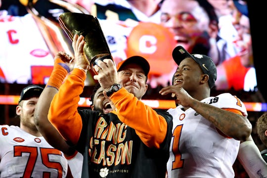 Clemson Tigers head coach Dabo Swinney celebrates with the national championship trophy after beating the Alabama Crimson Tide during the 2019 College Football Playoff Championship game.