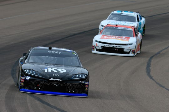 Kyle Busch, driver of the #18 Extreme Concepts/iK9 Toyota, leads a pack of cars during the NASCAR Xfinity Series iK9 Service Dog 200 at ISM Raceway in Avondale, Arizona.