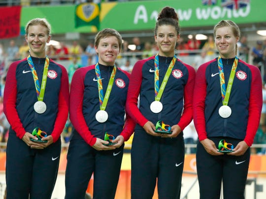 Kelly Catlin (shown second from left) with the rest of Team USA celebrating the silver medal in the women's cycling track team pursuit event at Rio Olympic Velodrome during the Rio 2016 Summer Olympic Games.