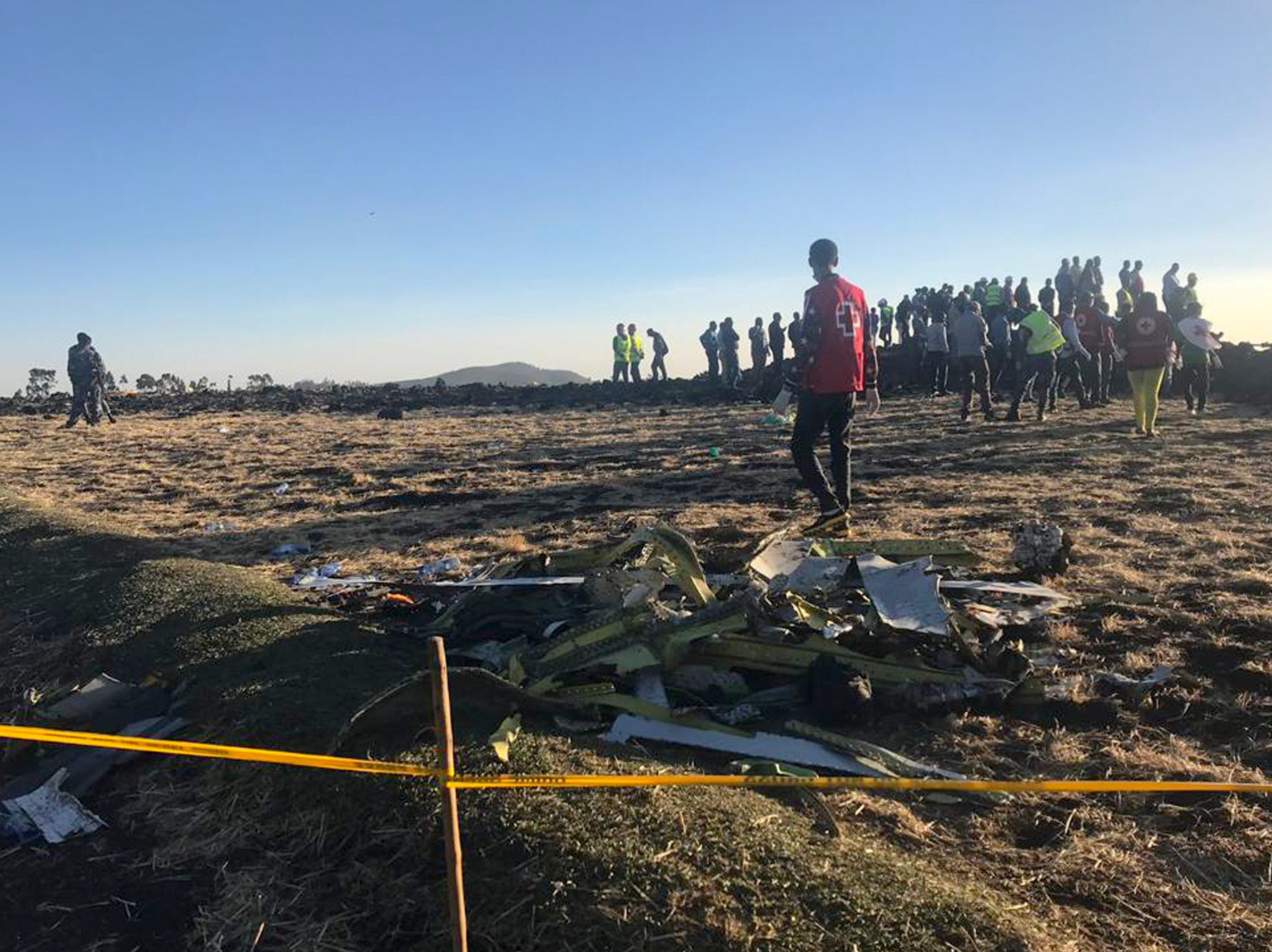 Rescuers search at the crash site of an Ethiopian Airlines plane.