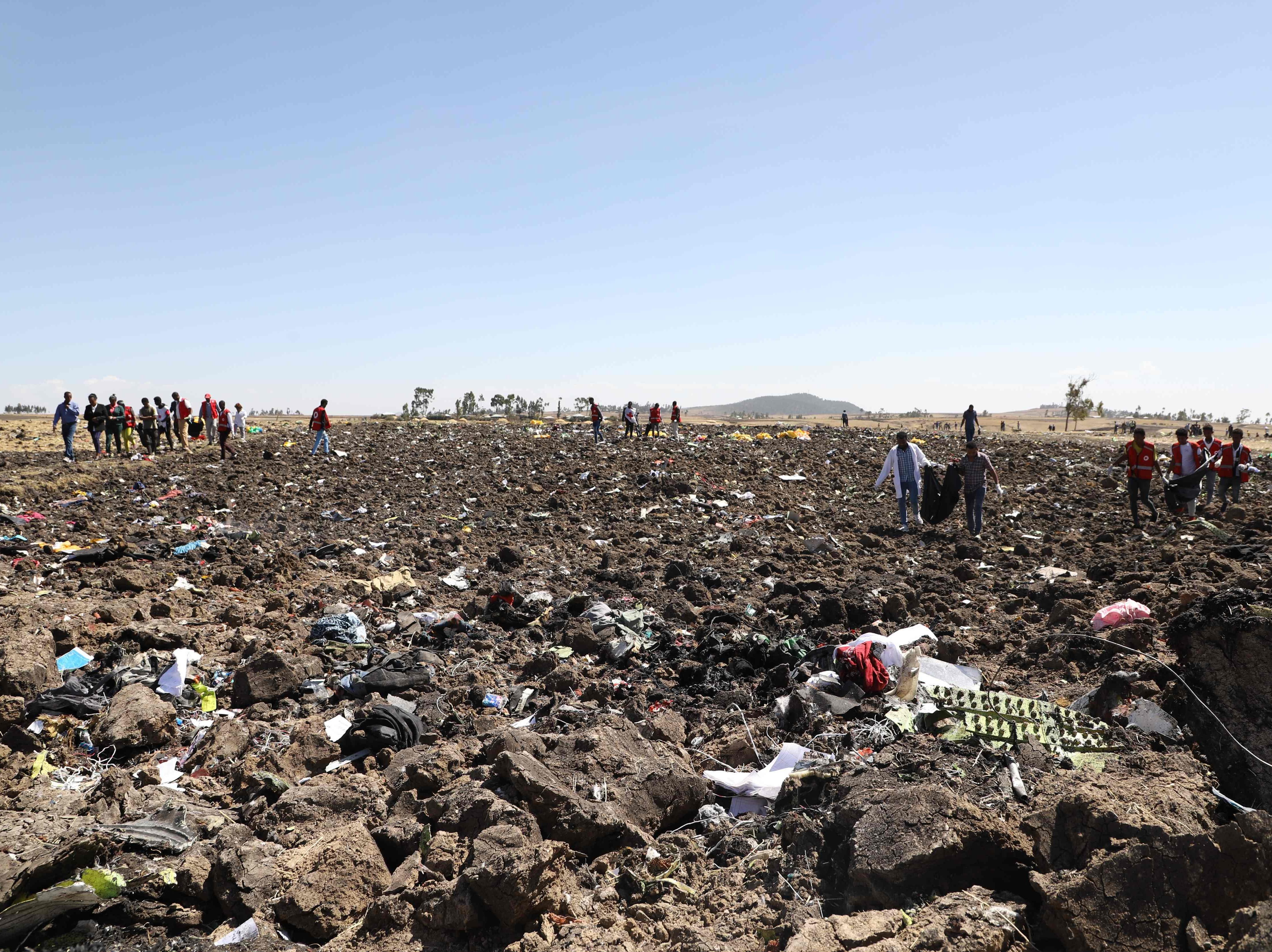Rescue teams collect bodies at the crash site of Ethiopia Airlines Flight 302 near Bishoftu, Ethiopia.