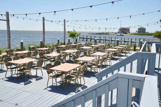 The deck ak at MJ's Restaurant, Bar & Grill overlooks a cove off Barnegat Bay.