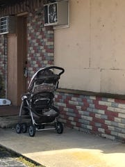 A baby stroller sits outside the Parkway Motel, Toms River, which was shut down on Friday
