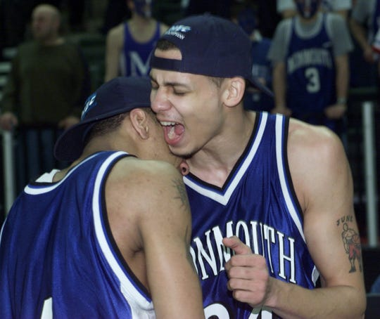 Monmouth's Rahsaan Johnson (left) and Gerry Crosby embrace after the Hawks won the 2001 NEC Tournament.
