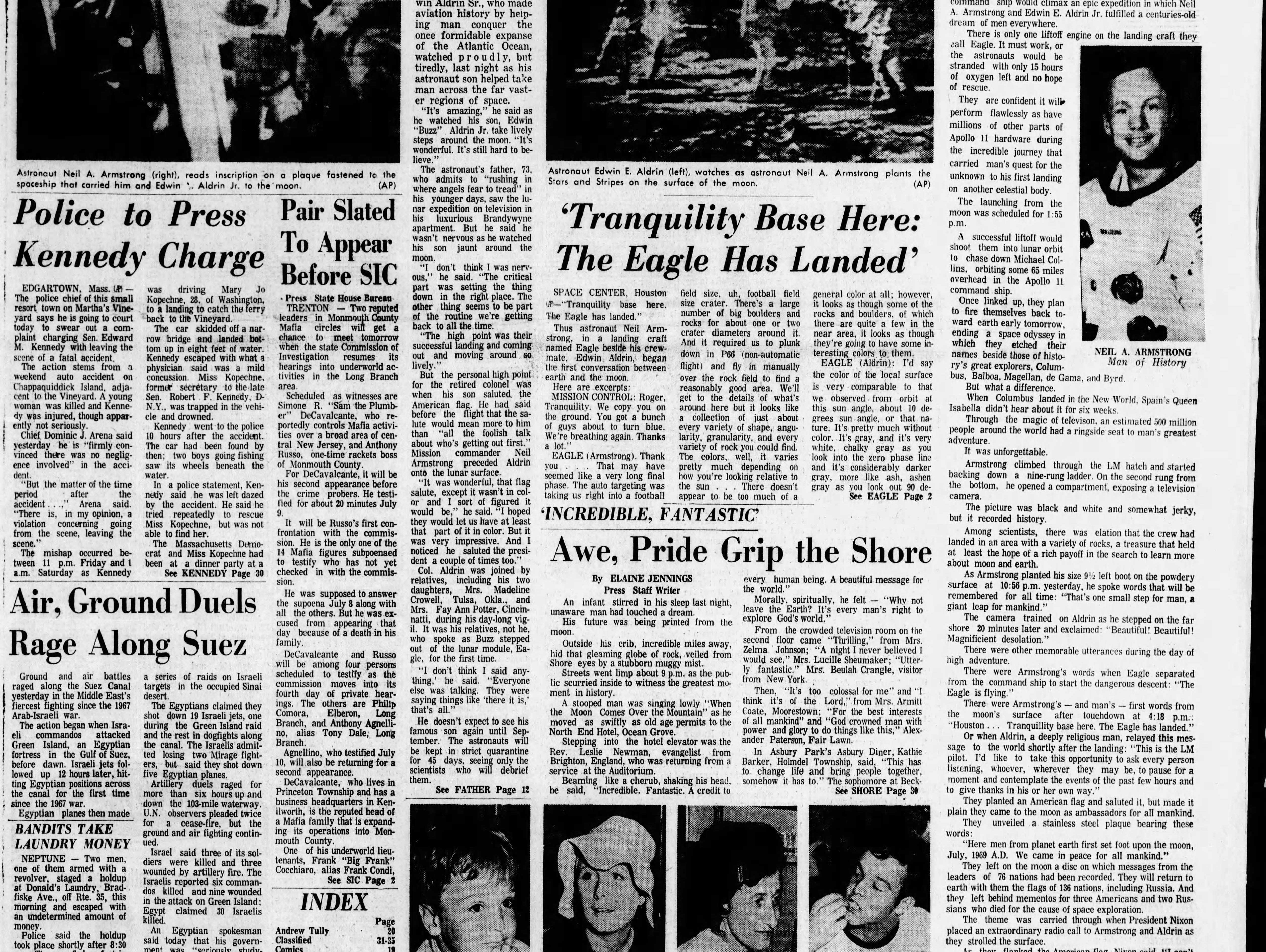 """Astronauts Neil Armstrong and Buzz Aldrin become the first human beings to step foot on the moon as """"awe, pride grip the Shore,"""" reports the Asbury Park Press in the Monday, July 21, 1969 edition."""