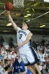 Monmouth's Tyler Azzarelli sails through the air for two of his game-high 19 points during the 2004 NEC Tournament final.