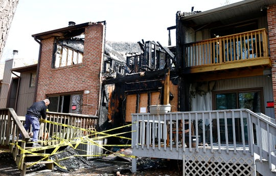 A fire investigator secures access Monday, March 11, 2019, to the back of 605 Bounty Court that was destroyed by an early Saturday morning fire in Toms River.  Emergency personnel was dispatched at 4:30 a.m. Saturday for smoke in a basement, but flames quickly spread throughout the structure.