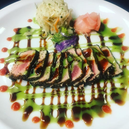 At MJ's Restaurant, Bar & Grille in the Bayville section of Berkeley Township, black pepper-crusted ahi tuna is served with spicy slaw. kabayaki sauce and wasabi aioli.
