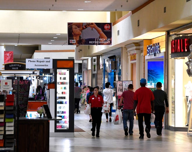 Shoppers walk through the Mall of Abilene on March 7.