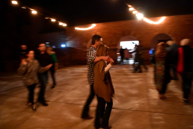 Dancing to recorded music, couples dance Saturday at the Dance under the stars at Abilene State Park.