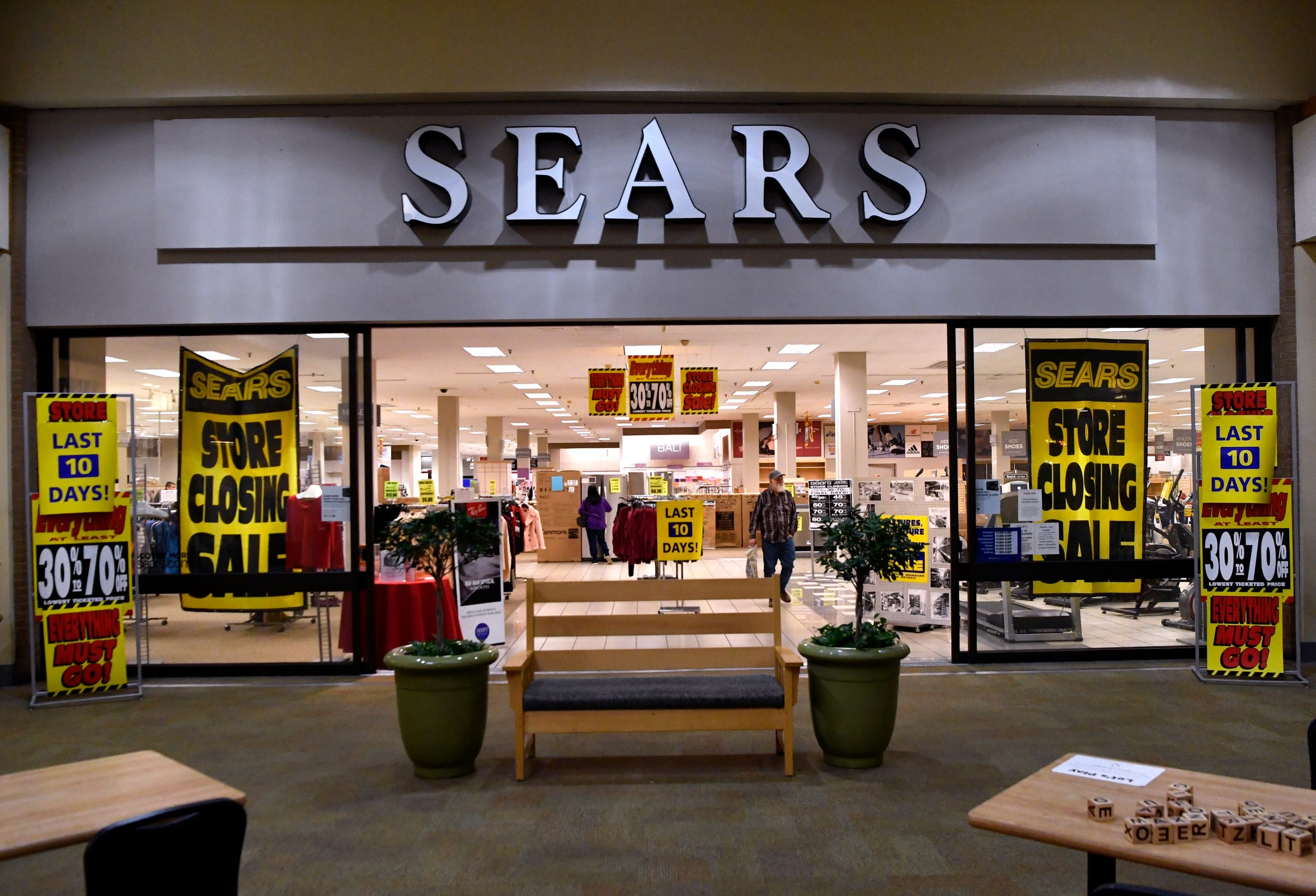 A shopper exits Sears on March 7 at the Mall of Abilene. The store closed for good March 17.