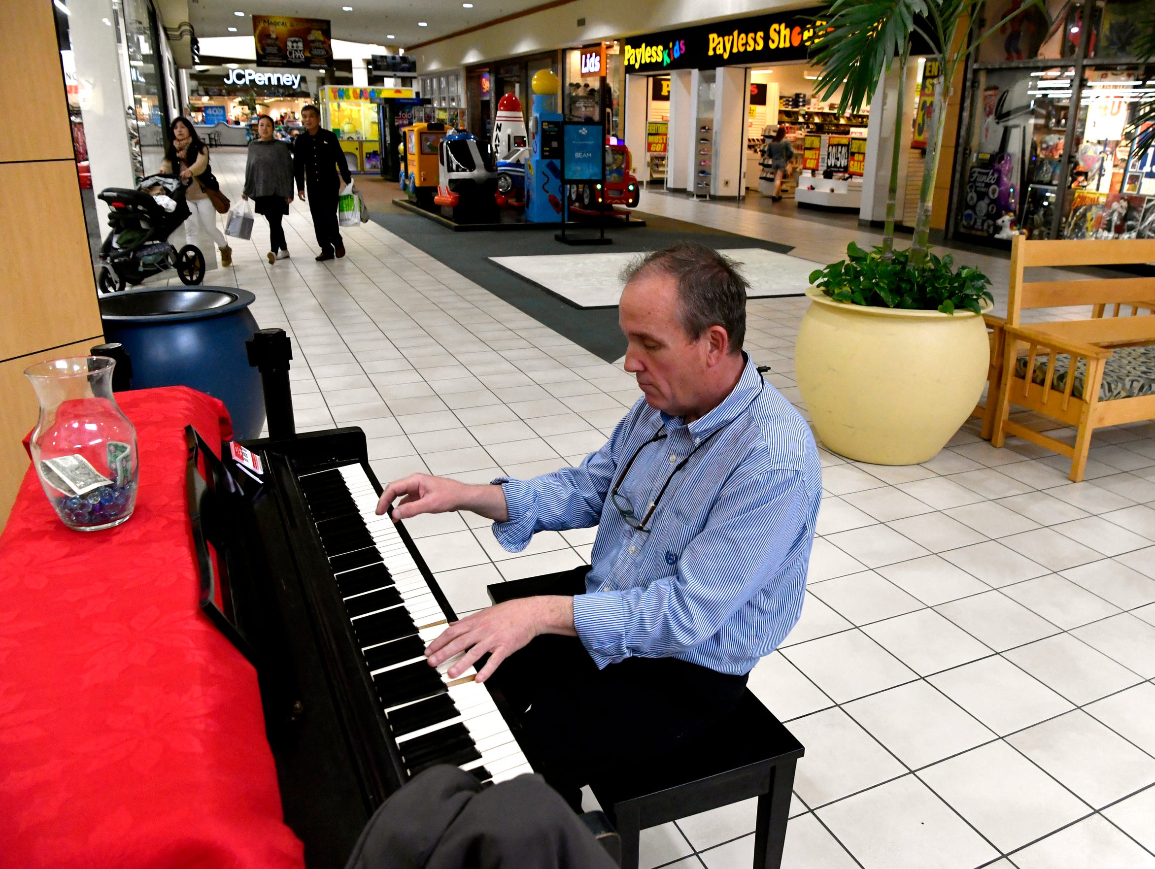 Brad White plays the piano March 7 in front of the Women's Dillard's store at the Mall of Abilene.
