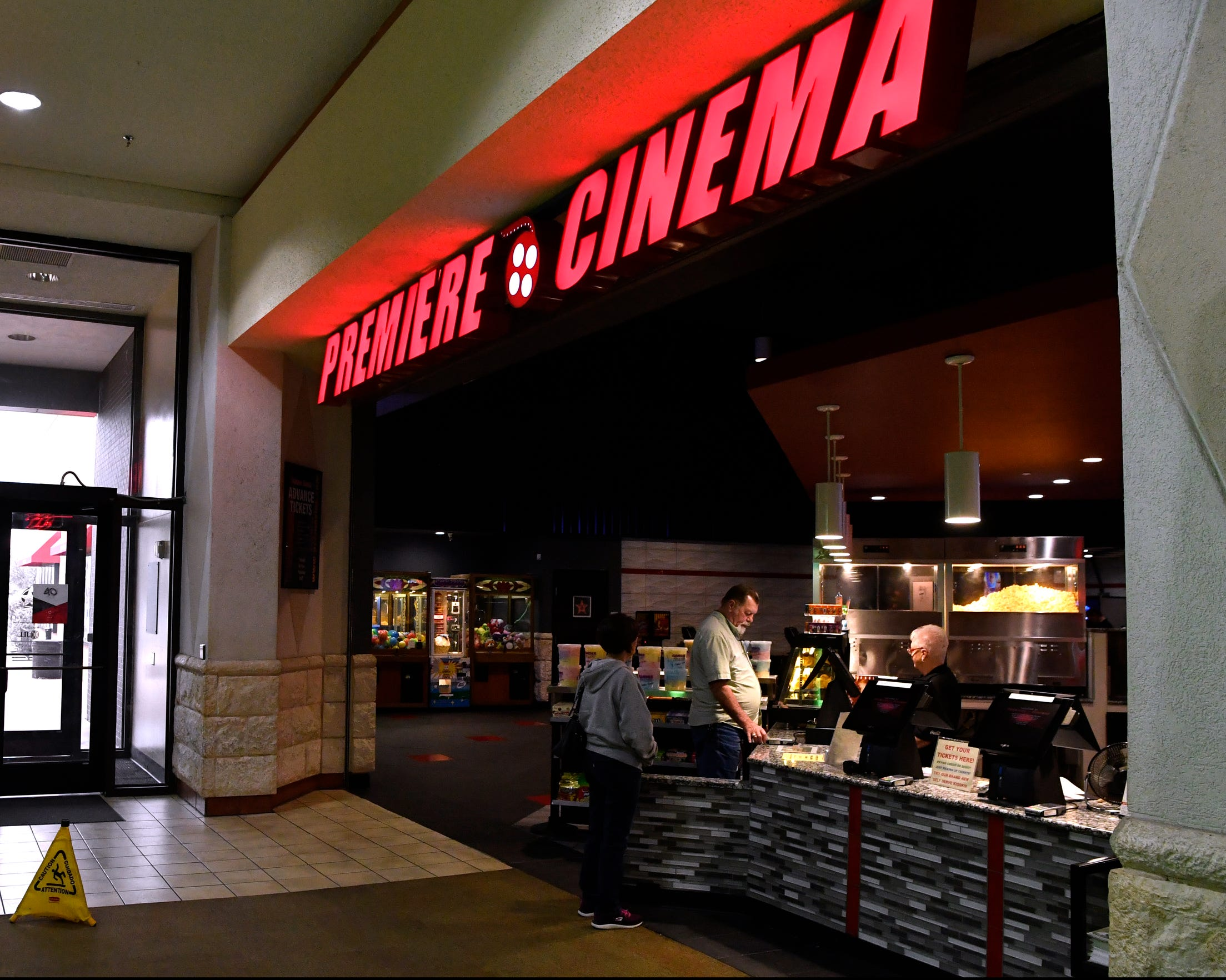 Patrons buy popcorn at Premiere Lux Cine 10 at the Mall of Abilene. There has been a movie theater at the mall since it opened 40 years ago and mall officials said it has been a feature they've worked hard on keeping as theaters modernized.