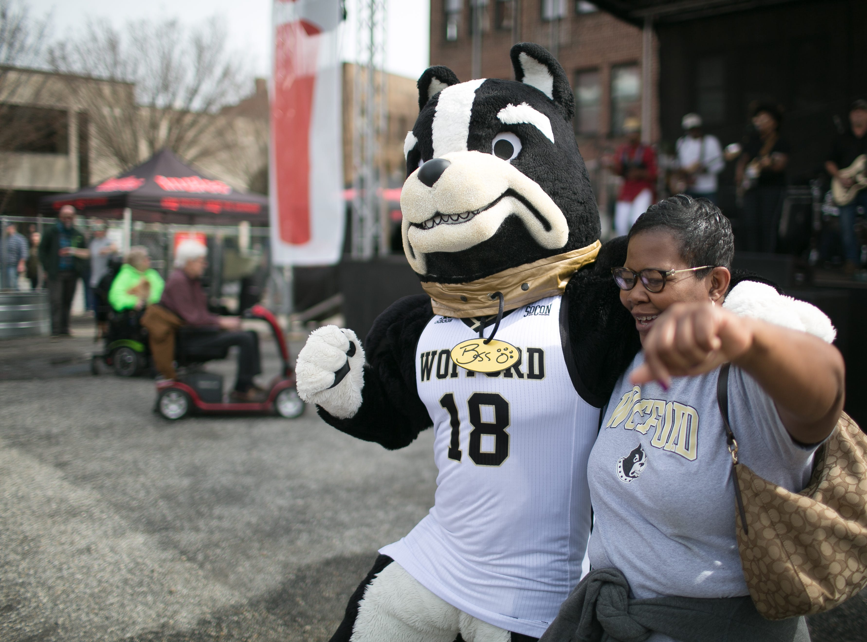 Wofford fans dance along as Lyric performs at the Ingles SoCon Fan Experience  across the street from the U.S. Cellular Center, at 68 Haywood St. in downtown Asheville, on March 10, 2019.