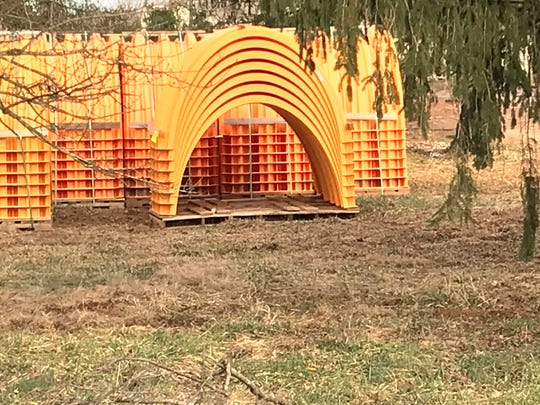These orange plastic arches are part of a storm water drainage system used at construction sites.