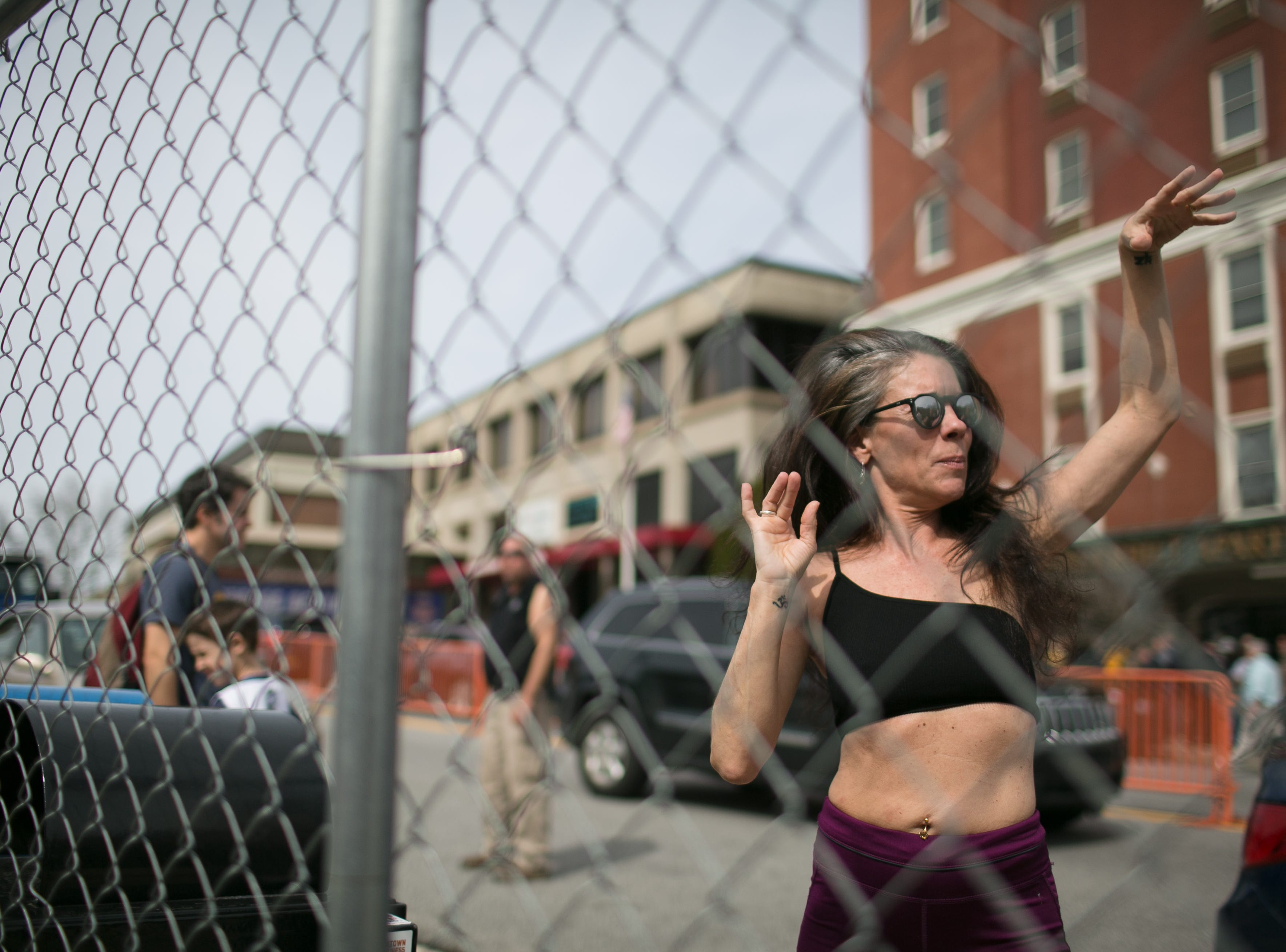 Fans dance as Lyric performs at the Ingles SoCon Fan Experience  across the street from the U.S. Cellular Center, at 68 Haywood St. in downtown Asheville, on March 10, 2019.