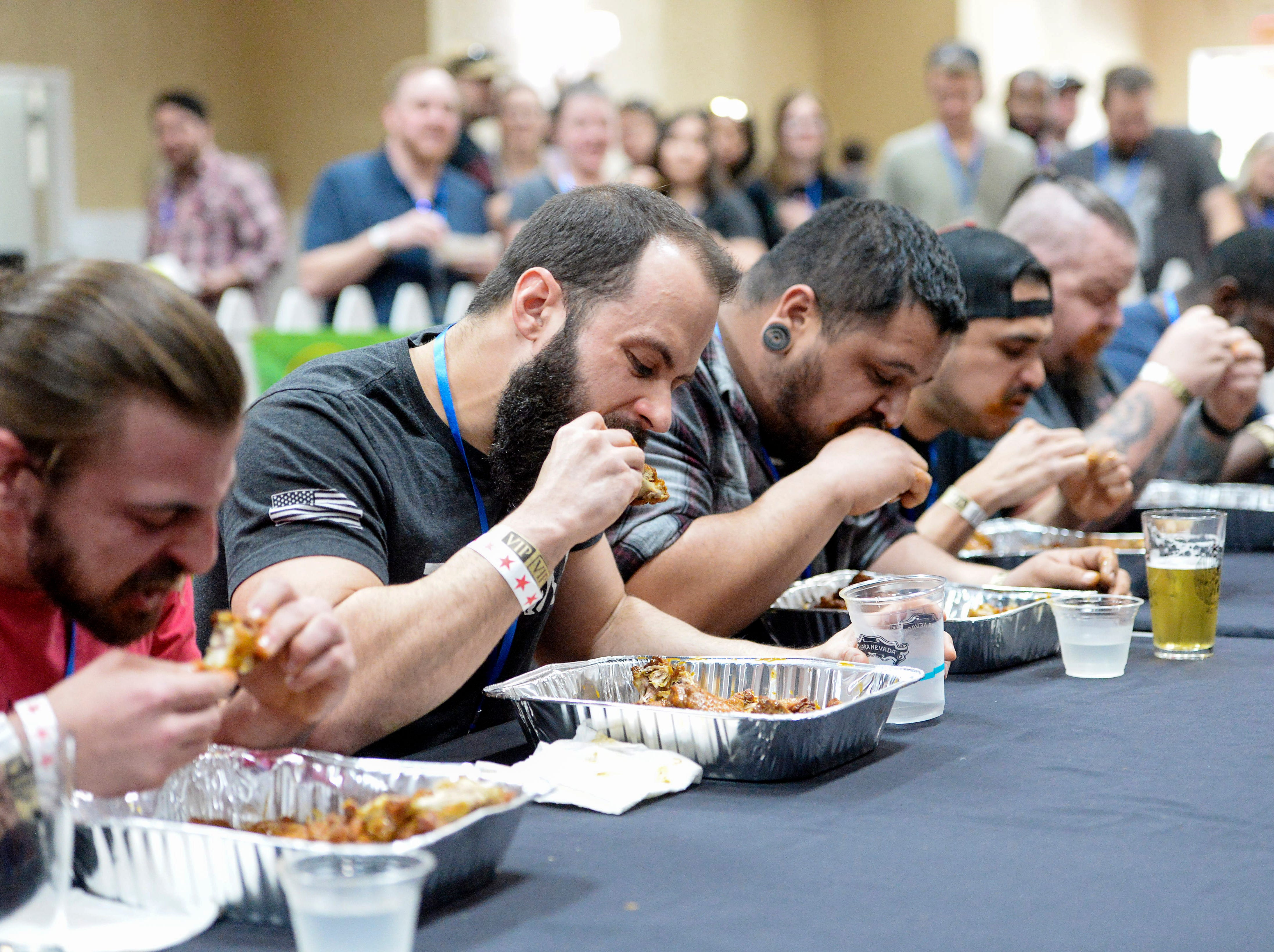 Participants sweat during the King of the Wing hot wing eating contest sponsored by Firewalker Hot Sauce during the 8th annual Asheville Wing War at the Crowne Plaza March 10, 2019 in Asheville.