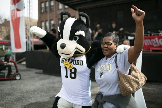 Shan Lovette dances with Wofford's mascot as Lyric performs at the Ingles SoCon Fan Experience across the street from the U.S. Cellular Center at 68 Haywood St., in downtown Asheville, on March 10, 2019.