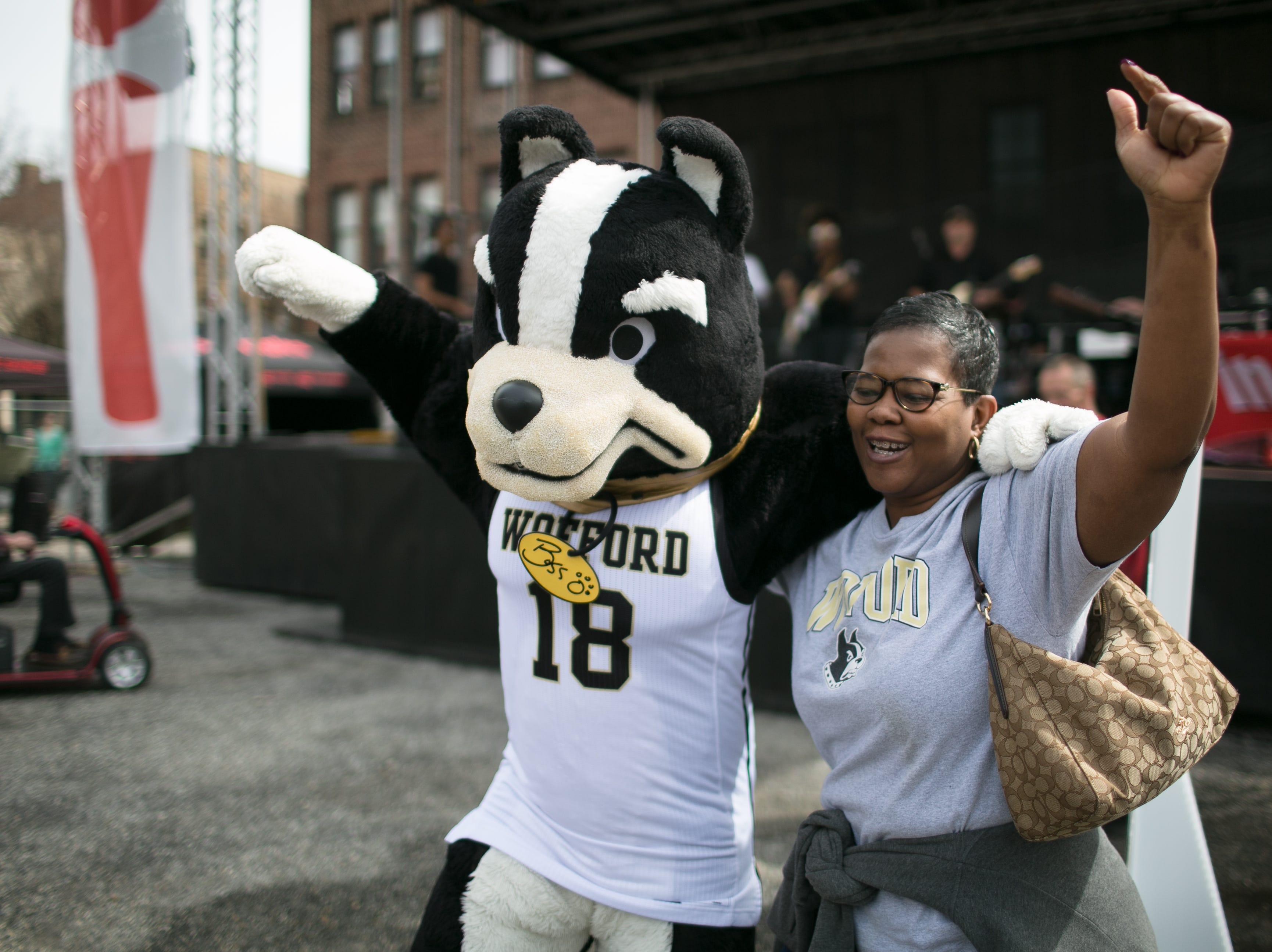 Shan Lovette danced with Wofford's mascot as Lyric performed across the street from the U.S. Cellular Center on Sunday, March 10th, 2019. -Colby Rabon (colbyrabon@gmail.com)
