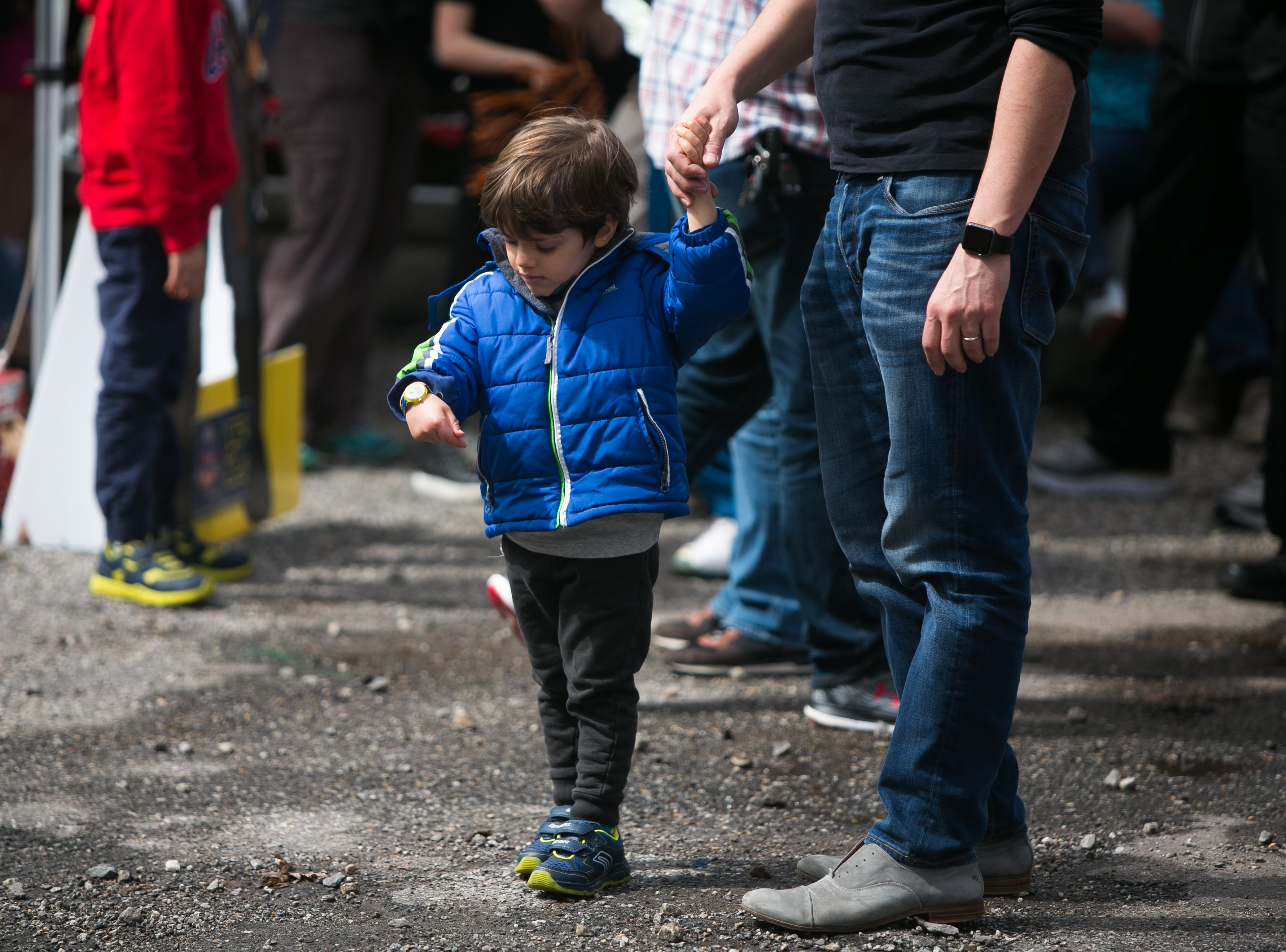 Fans dance and kids play as Lyric performs at the Ingles SoCon Fan Experience  across the street from the U.S. Cellular Center, at 68 Haywood St. in downtown Asheville, on March 10, 2019.