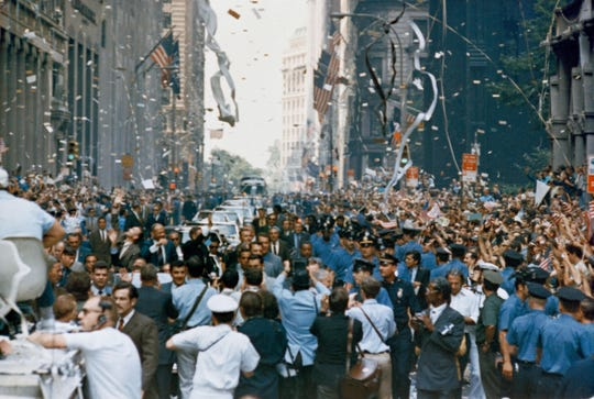 New York City welcomes the Apollo 11 crew in a ticker tape parade down Broadway and Park Avenue. Pictured in the lead car, from the right, are astronauts Neil A. Armstrong, Michael Collins and Buzz Aldrin. The three astronauts teamed for the first manned lunar landing, on July 20, 1969.