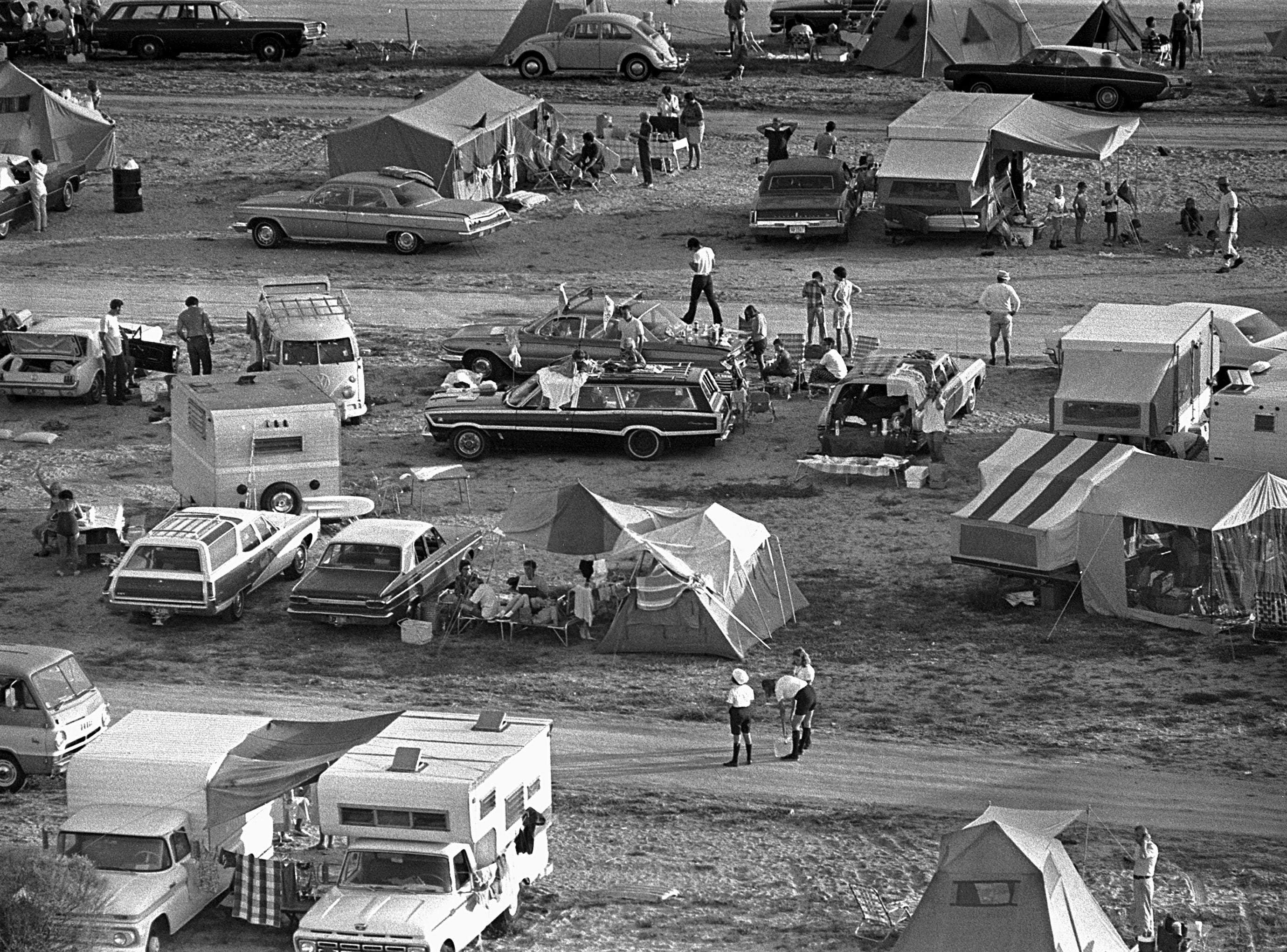 Adjacent to the Kennedy Space Center thousands of spectators camped out on beaches and roads to watch the launch of Apollo 11, which launched at 9:32 a.m. Eastern on July 16, 1969. The launch of Apollo 11 was the culmination of 8 years of hard work by thousands of scientists and technicians.