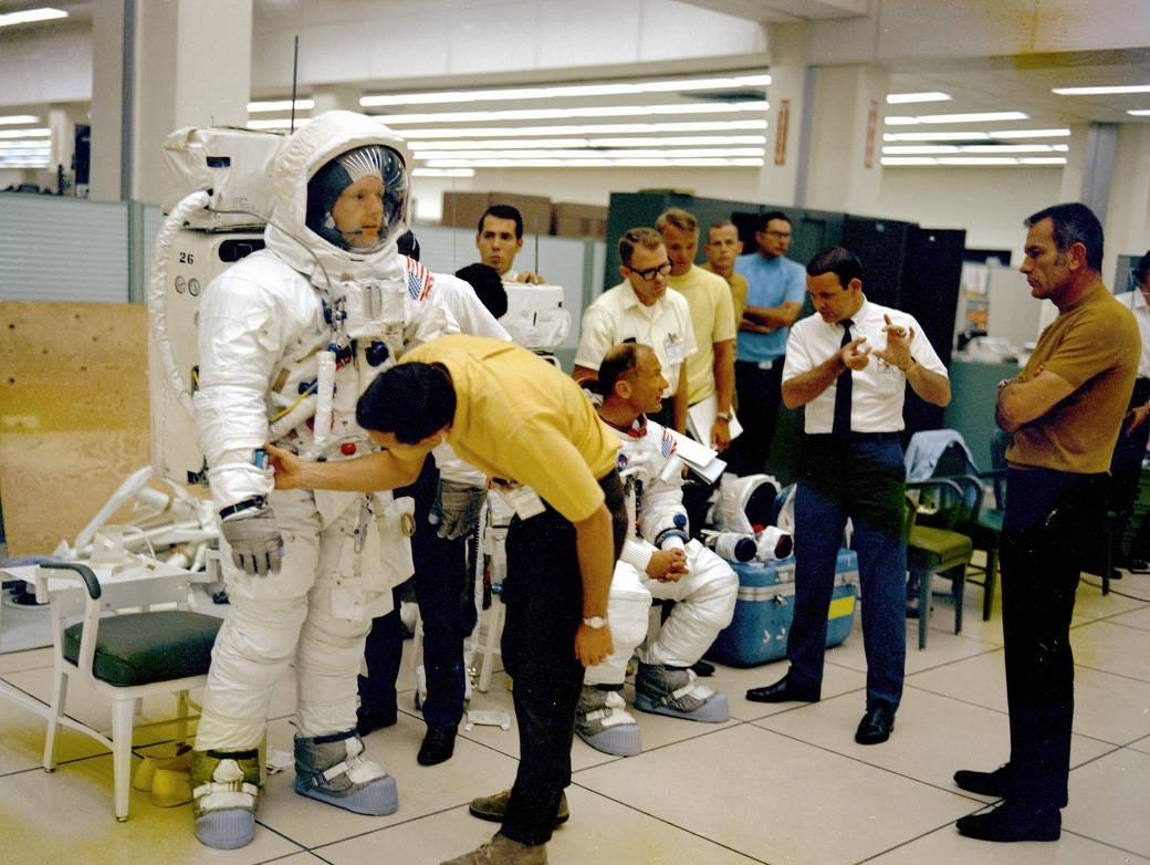 The Apollo 11 flight crew is given instructions by technicians and management while undergoing the extravehicular activity (EVA) training and the lunar module walk-through in preparation for the first manned landing on the moon.