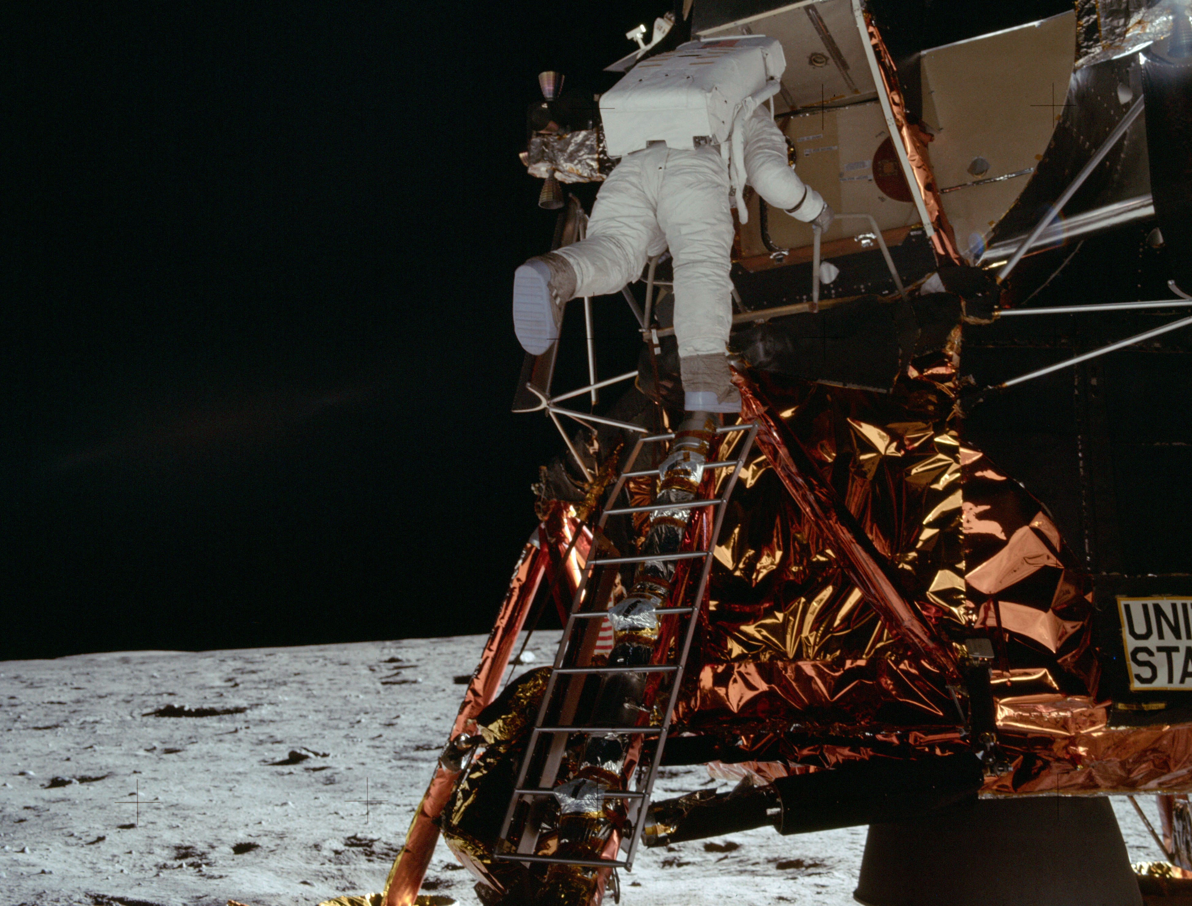 """Astronaut Edwin E. Aldrin Jr., lunar module pilot, egresses the Lunar Module (LM) """"Eagle"""" and begins to descend the steps of the LM ladder as he prepares to walk on the moon."""