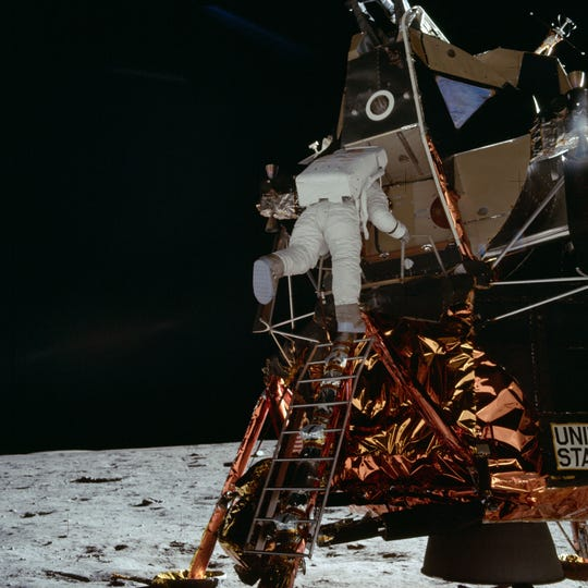 "Astronaut Edwin E. Aldrin Jr., lunar module pilot, egresses the Lunar Module (LM) ""Eagle"" and begins to descend the steps of the LM ladder as he prepares to walk on the moon."