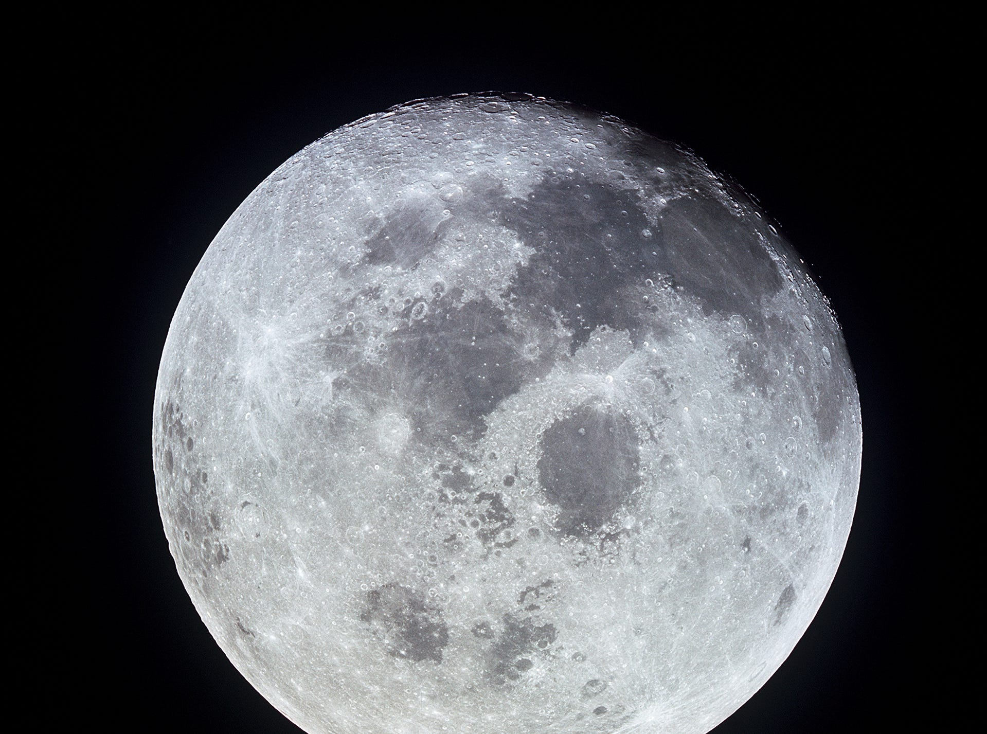 This outstanding view of the full moon was photographed from the Apollo 11 spacecraft during its trans-Earth journey homeward. When this picture was taken, the spacecraft was already 10,000 nautical miles away. On board Apollo 11 were commander Neil Armstrong, command module pilot Michael Collins and lunar module pilot Buzz Aldrin. While astronauts
