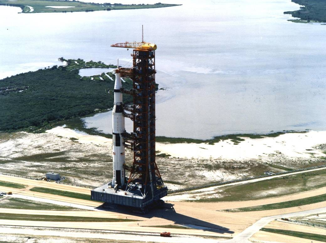 Carrying the Apollo 11 Saturn V rocket and mobile launcher, the crawler inches its way along the three-and-a-half-mile journey to Launch Pad 39A. The 363-foot-high space vehicle launched Apollo 11 astronauts Neil A. Armstrong, Michael Collins and Edwin E. Aldrin Jr. on the first manned lunar landing mission.