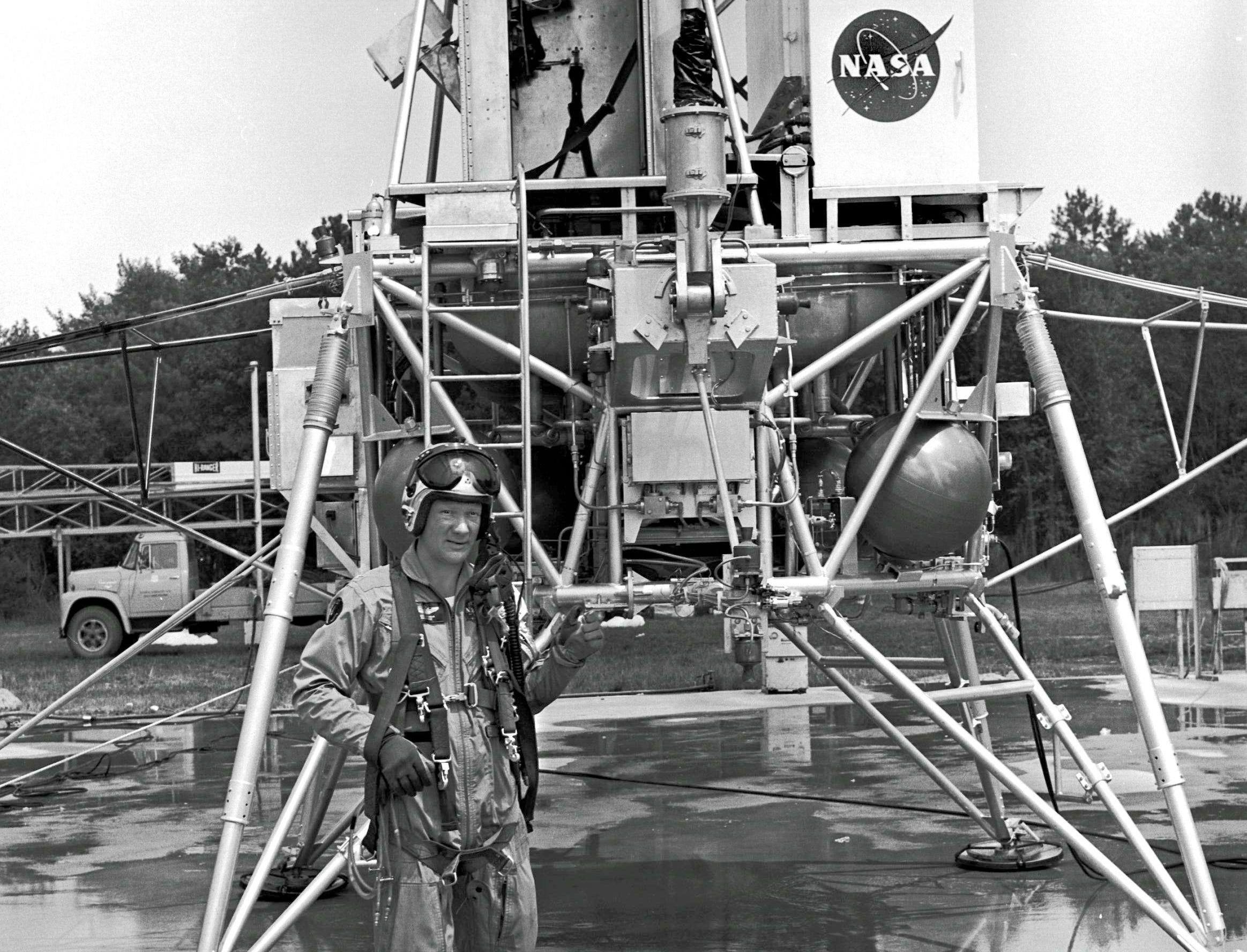 """Edwin """"Buzz"""" Aldrin, the second human to step on the surface of the moon is about to climb into the Lunar Module at the Langley Lunar Landing Research Facility. Aldrin was one of 23 astronauts who trained at the Langley facility in preparation for the final phase of the moon landing."""