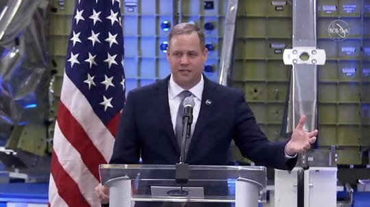 On Monday, March 11, in Kennedy Space Center's Operations and Checkout Building, NASA Administrator Jim Bridenstine discussed the Trump administration's proposed $21 billion spending plan for the space agency in the 2020 budget year that starts Oct. 1. An Orion crew capsule being prepared for a test flight around the moon provided a backdrop.