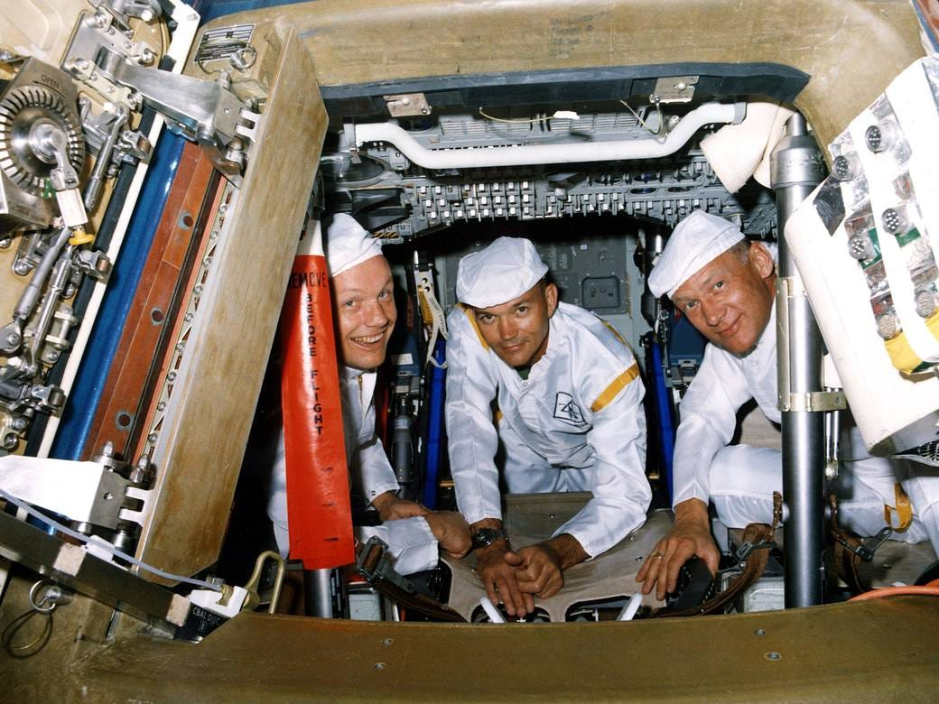 The Apollo 11 crew performs a walk-through egress test. The hands-on test was in preparation for the first manned lunar landing mission.