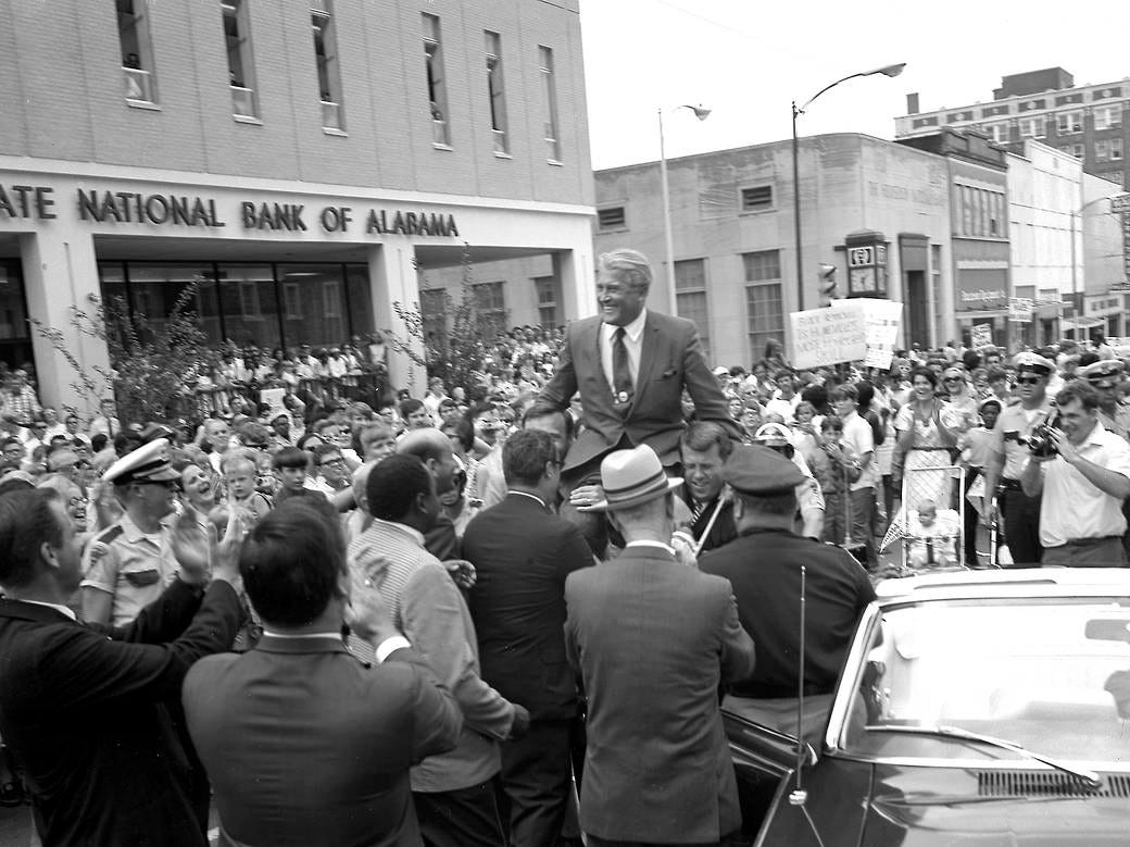 Dr. Wernher von Braun, the first center director of NASA's Marshall Space Flight Center is carried aloft on the shoulders of city officials during the Apollo 11 celebration in downtown Huntsville on July 24, 1969.